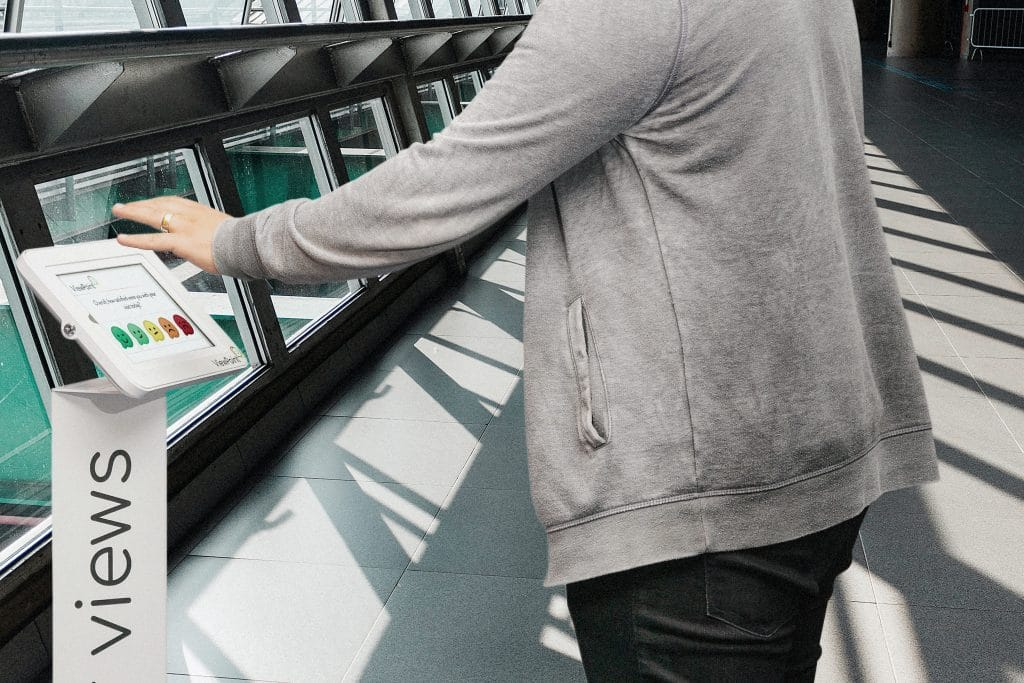 Airport Touchless feedback Device Being Used