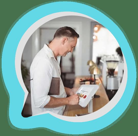 Man using a push button feeedback machine at a counter